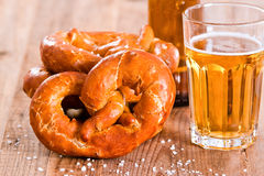 Bavarian pretzels. Bavarian pretzels with beer on wooden table Royalty Free Stock Images