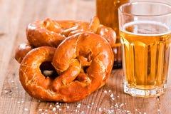 Bavarian pretzels. Bavarian pretzels with beer on wooden table Royalty Free Stock Images