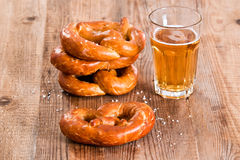 Bavarian pretzels. Bavarian pretzels with beer on wooden table Royalty Free Stock Photography