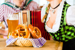 Bavarian restaurant with beer and pretzels Royalty Free Stock Image