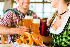Bavarian restaurant with beer and pretzels Royalty Free Stock Photo