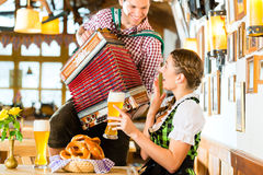 Bavarian restaurant with beer and pretzels Royalty Free Stock Photography