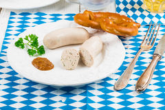 Bavarian sausage with pretzel, sweet mustard Royalty Free Stock Images