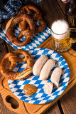 Bavarian sausage with pretzel, sweet mustard Royalty Free Stock Image