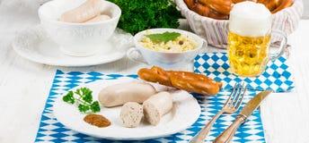 Bavarian sausage with pretzel, sweet mustard Royalty Free Stock Image