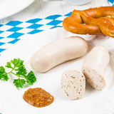 Bavarian sausage with pretzel, sweet mustard and beer Royalty Free Stock Photos