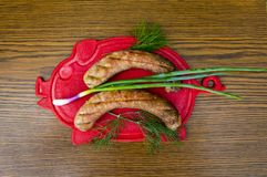 Bavarian sausages on a cutting board with vegetables royalty free stock images