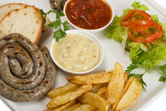 Bavarian sausages on the grill, french fries Stock Images