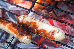 Bavarian sausages on a grill Stock Photography