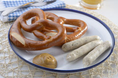 Bavarian sausages with pretzels Stock Image