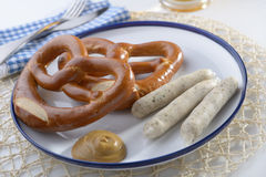 Bavarian sausages with pretzels Stock Photos