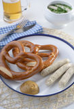 Bavarian sausages with pretzels Royalty Free Stock Photos