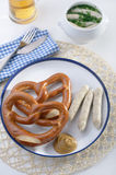 Bavarian sausages with pretzels Stock Photography