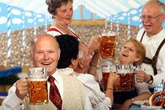 Bavarian Seniors. Bavarian Bosses sitting in a beer tent and having fun royalty free stock photography