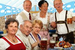 Bavarian Seniors. Bavarian Bosses sitting in a beer tent and having fun stock photography