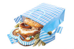 Bavarian shopping bag. Bavarian Oktoberfest paper shopping bag with gingerbread heart, soft pretzel, hops and wheat from Germany stock photos
