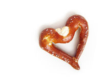 A bavarian soft pretzel in heart shape (2). A bavarian soft pretzel in heart shape, the heart as sign for love and a pretzel for eating Royalty Free Stock Photo