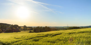 Bavarian spring landscape. Lovely picturesque picture of a Bavarian spring landscape. Shot in Upper Franconia near the Giechburg. With riping grain in the Royalty Free Stock Images