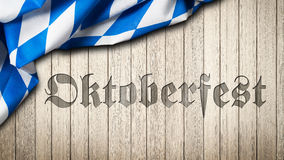 Bavarian tablecloth on a wooden background with the carved out word Oktoberfest Stock Photo
