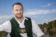 Bavarian tradition man at the lake Royalty Free Stock Images