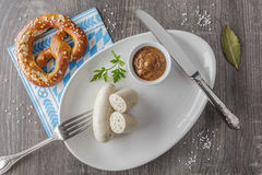 Bavarian veal sausages with pretzel. And sweet mustard. Top view Royalty Free Stock Photo