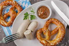 Bavarian veal sausages with pretzel. Top view Royalty Free Stock Photo
