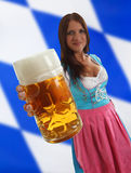 Bavarian Waitress holding Oktoberfest Beer Royalty Free Stock Image