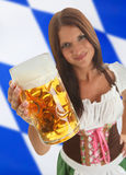 Bavarian Waitress holding Oktoberfest Beer Stock Photos