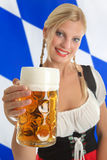 Bavarian Waitress with Oktoberfest Beer Royalty Free Stock Images