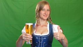 Bavarian waitress serving beer, looking in camera.  stock photo