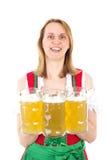 Bavarian waitress serving beer Royalty Free Stock Photos