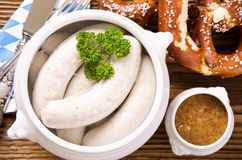 Bavarian Weisswurst Breakfast. As closeup on a wooden table Stock Images