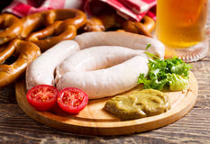 Bavarian white sausages with pretzel and mug of beer Stock Photo