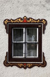 Bavarian window with typical painted frame Royalty Free Stock Photo
