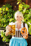Bavarian woman with beer glass and bretzel Stock Image