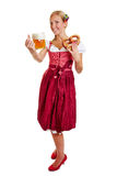 Bavarian woman with beer and pretzel Stock Images