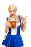 Bavarian woman with beer and thumbs up. Royalty Free Stock Images