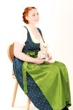 Bavarian woman with cell phone and Teddy Royalty Free Stock Image