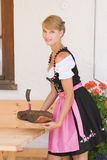 Bavarian woman in a dirndl Stock Images