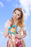 Bavarian woman with dirndl and ginger bread. Bavarian women with dirndl and ginger bread smiling royalty free stock images