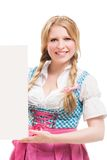 Bavarian woman in dirndl, holding blank signboard. Stock Photography