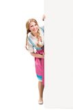 Bavarian woman in dirndl, holding blank signboard. Stock Image