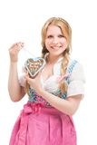 Bavarian woman in dirndl, holding lebkuchen. Royalty Free Stock Photos