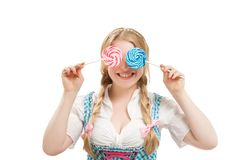 Bavarian woman in dirndl, holding lollipop. Stock Photo