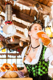 Bavarian woman drinking wheat beer Stock Images
