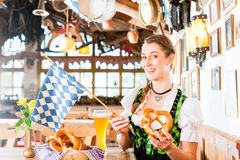 Bavarian woman drinking wheat beer Stock Image