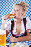 Bavarian woman and eat royalty free stock photo