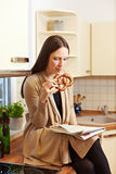 Bavarian woman eating Pretzel Royalty Free Stock Image