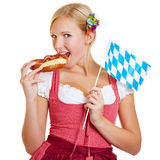 Bavarian woman eating a pretzel Stock Images