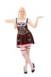 Bavarian woman holding an imaginary tray Stock Photography